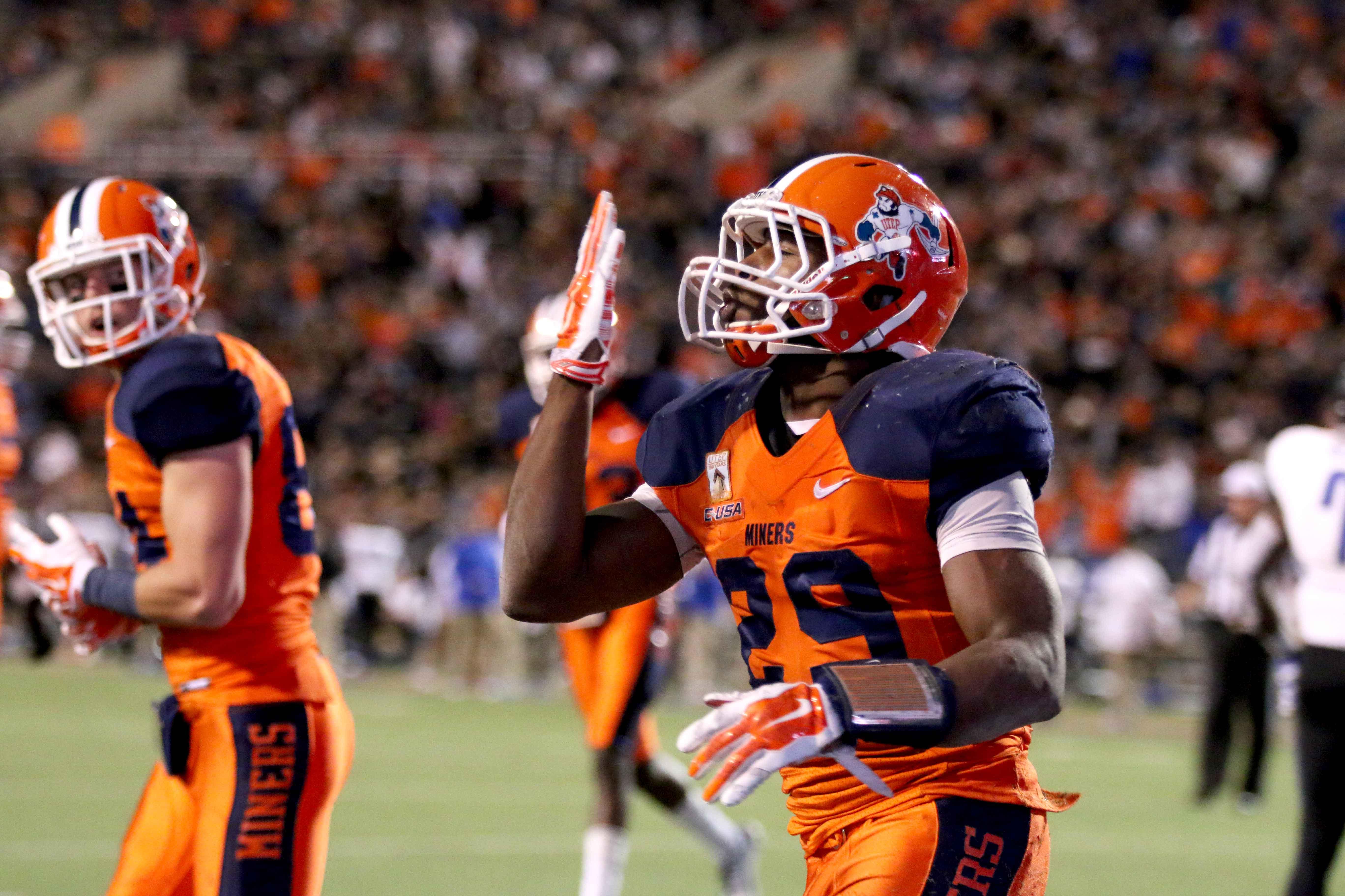 Junior running back Aaron Jones celebrates after a touchdown.