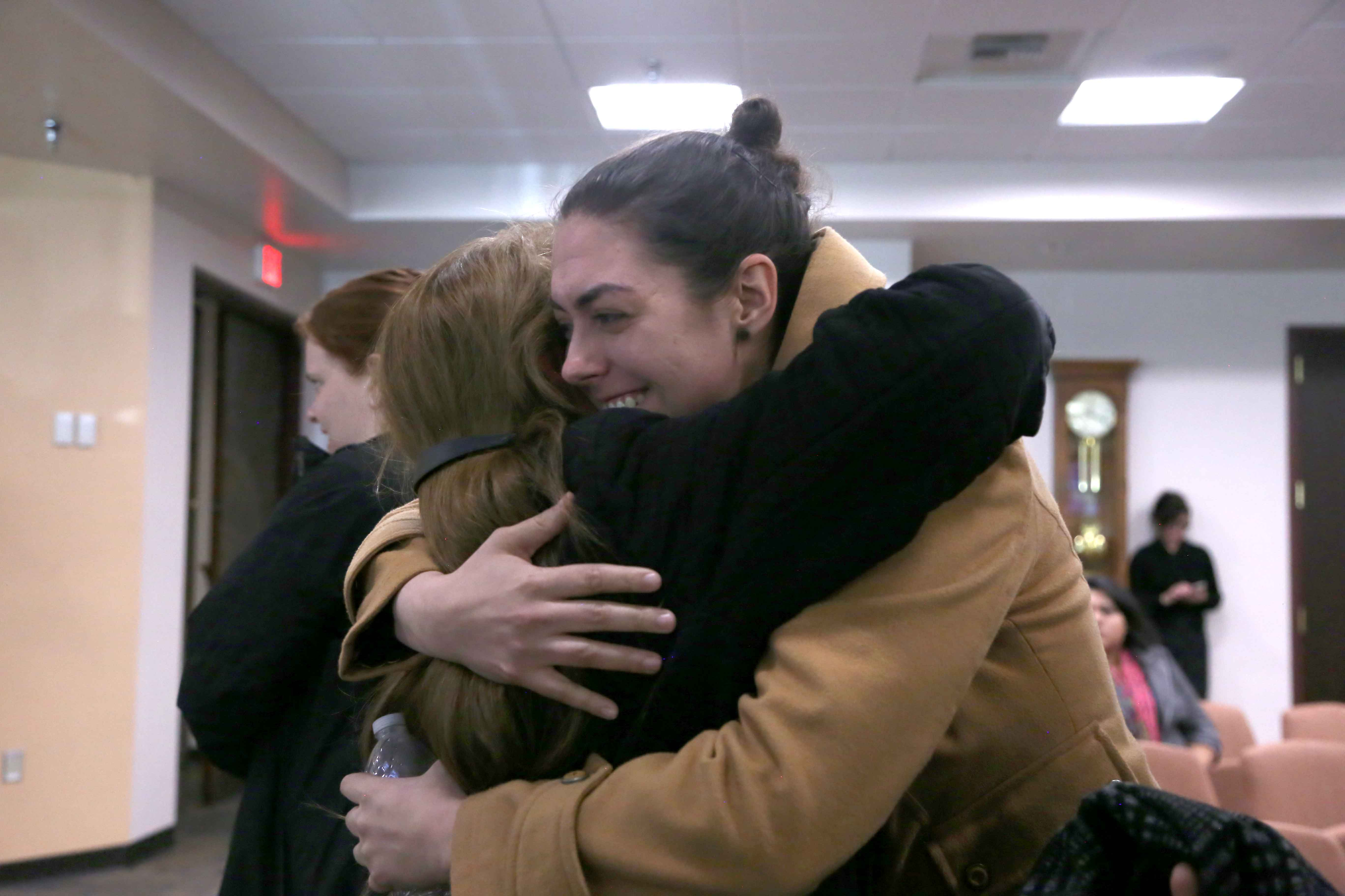 Proponents of saving Duranguito hug after hearing city council's decision.