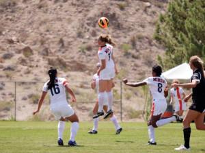 Junior forward, Angela Cutaia, wins the ball in the air against Nebraska-Omaha on Aug. 25.
