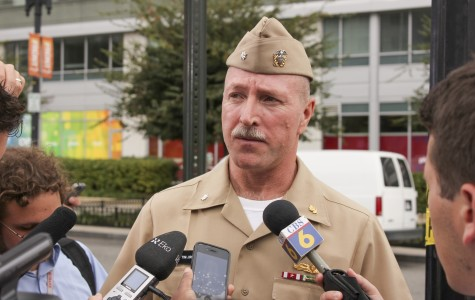 Navy Cmdr. Tim Jirus says that a man standing next to him was shot and killed as both tried to escape from the shooter at the Washington Navy Yard on Monday. SHFWire photo by Nick Prete