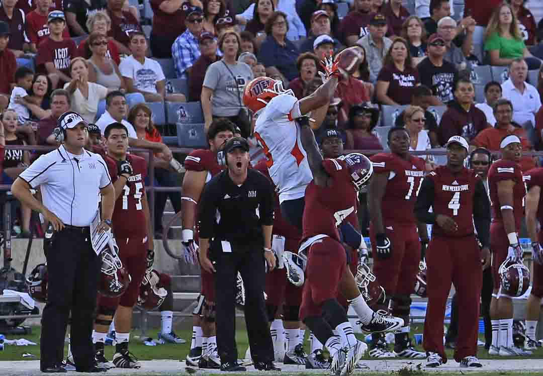 Junior wide receiver, Jordan Leslie catches the long pass from Jameill Showers in the game against NMSU on Sept. 14.