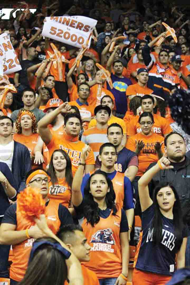 Students cheering on the Miners at a men's basketball game.