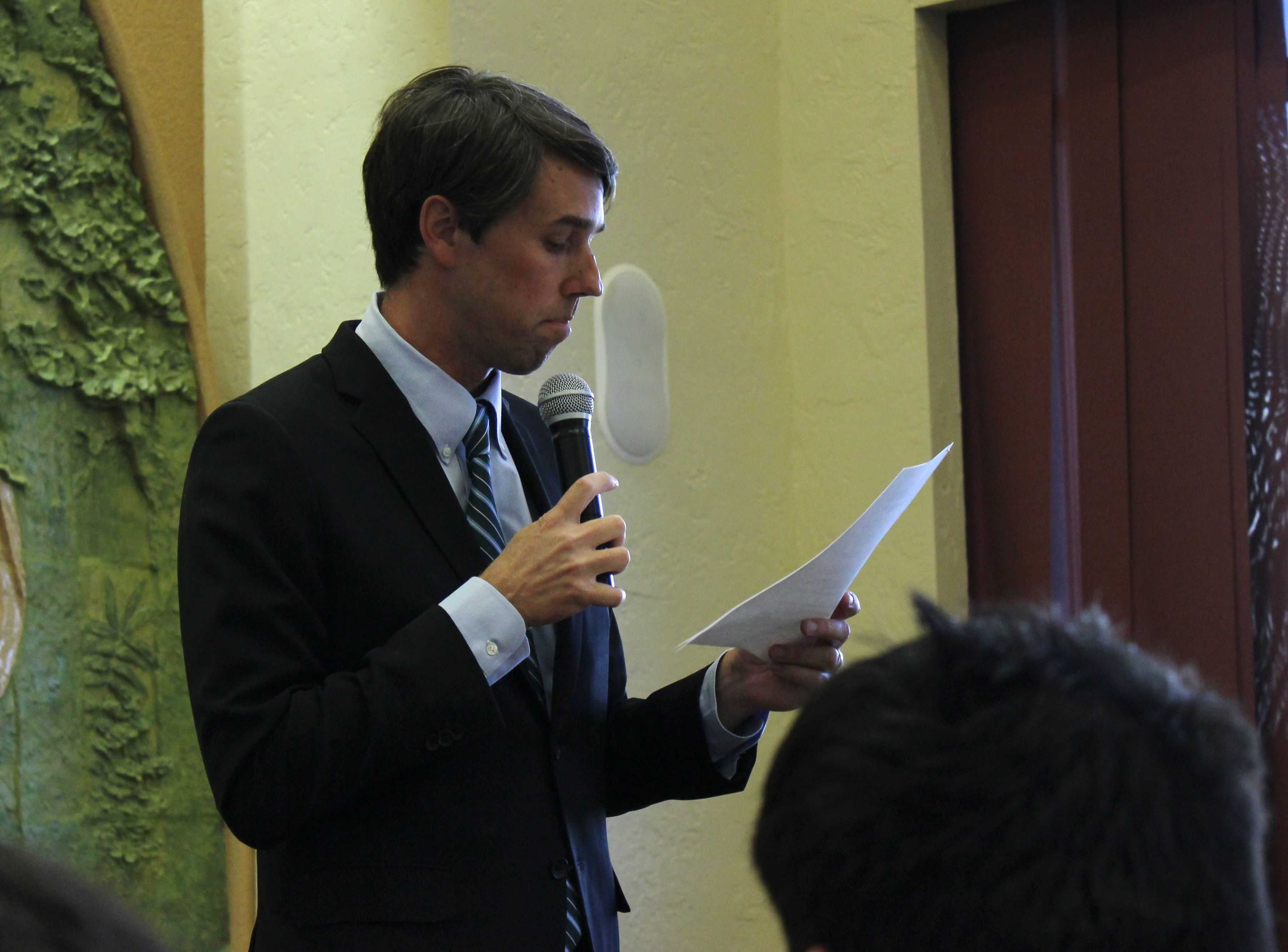 Rep. Beto O'Rourke (D-Texas) reads a resolution offered by the Obama Administration about scenarios of U.S. action in Syria.