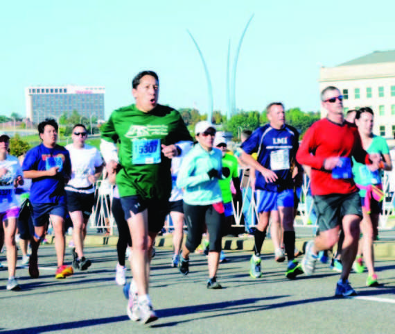 The Army Ten Miler runners make their way to the finish line Sunday morning. Nearly 35,000 runners were registered to run the annual race.