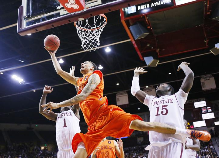 Senior center John Bohannon attempts to make a layup against New Mexico State on Nov. 15. UTEP lost 86-73.