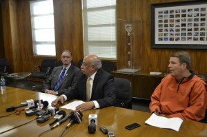 Athletic Director Bob Stull (left) vice president of legal affairs Richard Adauto (middle) and head coach Tim Floyd (right) inform the media about the three ousted players.