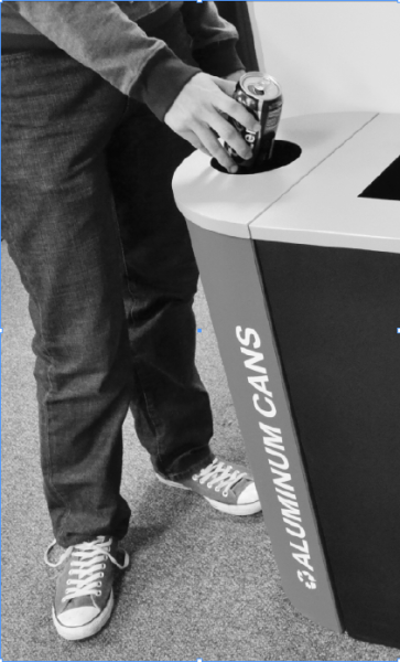 A student uses the new recycling bins placed in Union Building East.