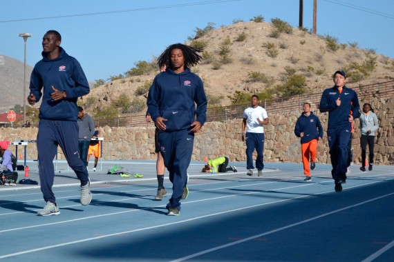 Men%E2%80%99s+4x4+relay+members+Abiola+Onakoya+%28left%29+and+Carnell+Horn+%28right%29+warmup+at+the+Kidd+Field.+