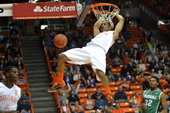 Miners hold off Marshall's late rally for first conference win