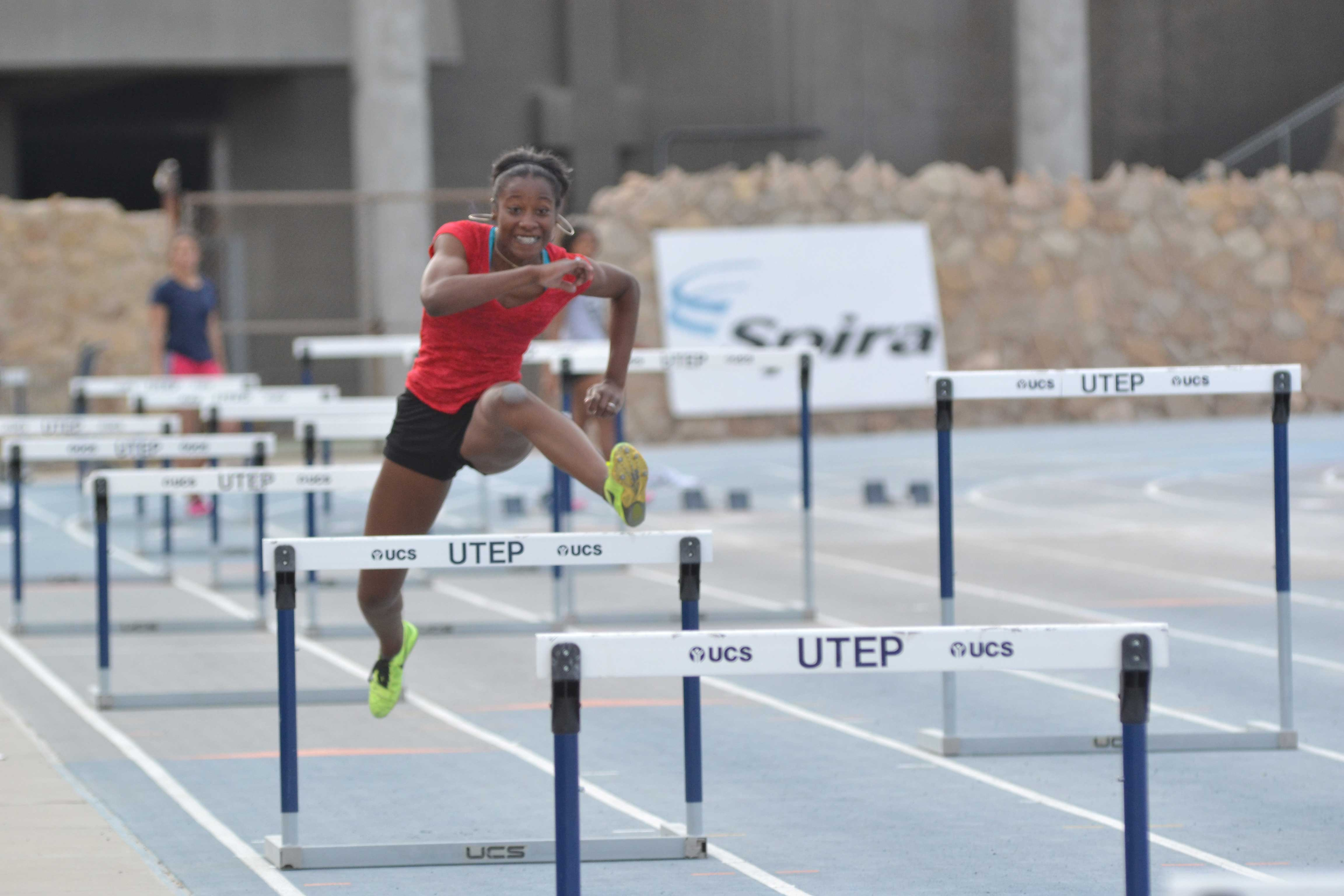 Sophomore hurdler/jumper Bria Love practices the 60-meter dash with hurdles at Kidd Field.