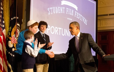 David Posnack Jewish Day School seventh-grader Kyle Weintraub, 12, of Davie, Fla., shakes hands with President Barack Obama at the first White House Film Festival. Kyle, who uses a robot to attend school from a hospital in Pennsylvania, was the subject of a student film recognized by Obama.