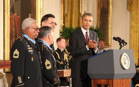 Sgt. 1st Class Melvin Morris, left, Master Sgt. Jose Rodela and Sgt. Santiago J. Erevia all Army soldiers during the Vietnam War, stand as President Barack Obama and a crowd applaud after they received the nation's highest military honor, the Medal of Honor on Tuesday at the White House. Of 24 soldiers who received the award, they were the only three still alive.