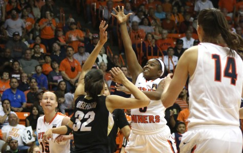 Kelli Willingham attempts a layup up over Buffs defender Arielle Roberson.