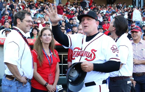 Manager Pat Murphy salutes the sold out crowd on opening day of the new ballpark.