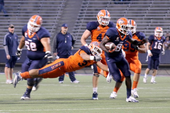 Sophomore+running+back+Autrey+Golden+breaks+a+tackle+from+senior+linebacker+Anthony+Puente+during+the+Orange+and+Blue+Game+on+April+11.