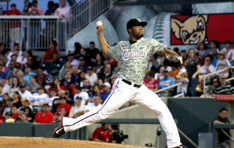 Starting pitcher Keyvius Sampson throws a fast ball against Isotopes during the fifth inning.