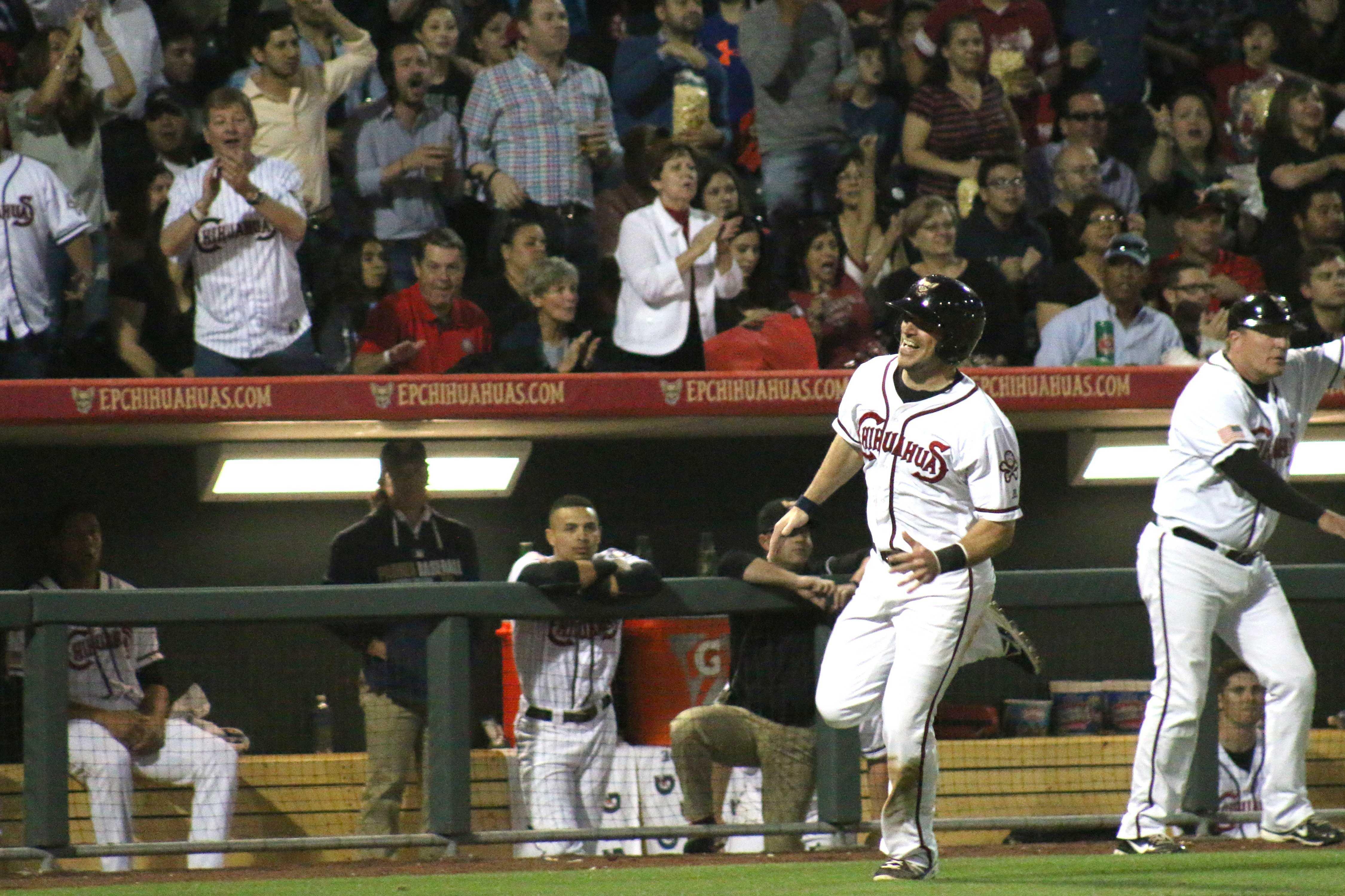 Infielder Cody Decker runs toward home plate.