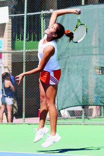 Junior Davina Meza hits a serve a first serve at the El Paso Tennis Club.
