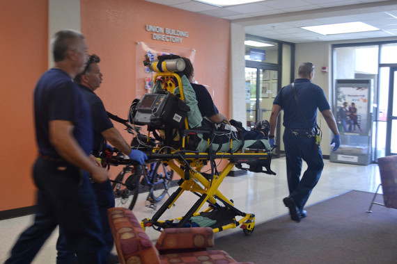 Female+wheeled+out+from+Union+Building+by+EMTs