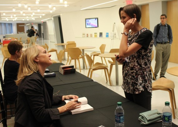 """Piper Kerman signs copies of her book, """"Orange Is the New Black"""" about the mistreatment of women in prisons after she was given an award Wednesday in Washington for her work on prison reform issues."""