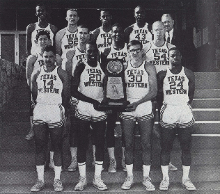 The complete '66 team posing with the trophy outside of Memorial Gym.