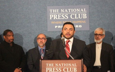 Ahmed Bedier, president of United Voices for America, center, urges the Muslim community to discourage their youth from joining the Islamic State group. Masjid Muhammad Assistant Imam Ben Abdul-Haqq, left, Secretary General for the U.S. Council of Muslim Organizations Oussama Jamal and Fiqh Council of North America Chairman Muzzammil H. Siddiqi, right, look on.
