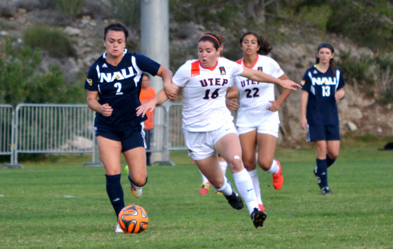Freshman+midfielder+Jeanna+Mullen+dribbles+past+a+Northern+Arizona+defender+at+University+Field.+