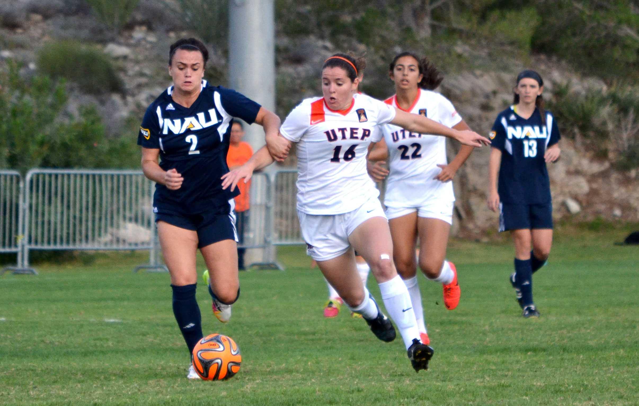 Freshman midfielder Jeanna Mullen dribbles past a Northern Arizona defender at University Field.