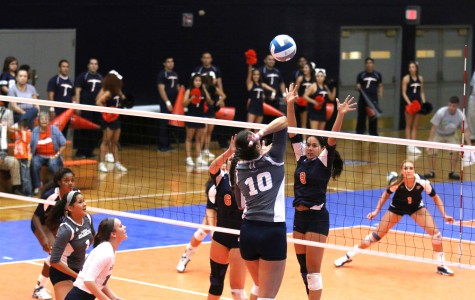 Junior outside hitter Talia Jones sets up for a block.