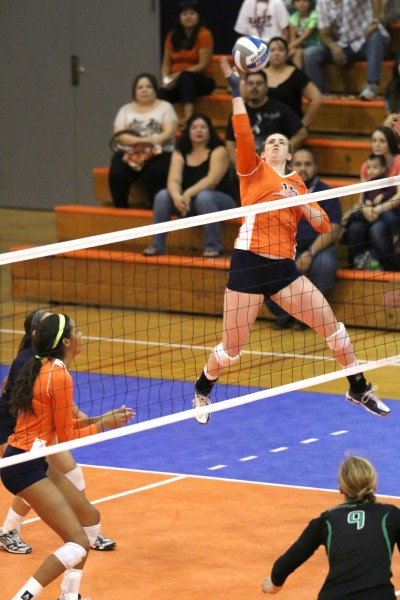 Senior outside hitter Jacqueline Cason attempts an attack against North Texas.