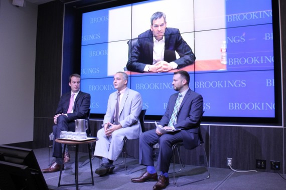 Wells Bennett, left, Benjamin Wittes, John Villasenor – on the screen – and Gregory McNeal say how federal and state governments regulate drones and other civilian robotics will affect when consumers can begin to use them.