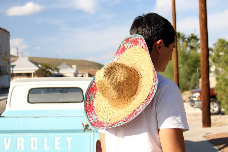 Former+student+Gabriel+Villanueva+wears+a+sombrero+for+Halloween.