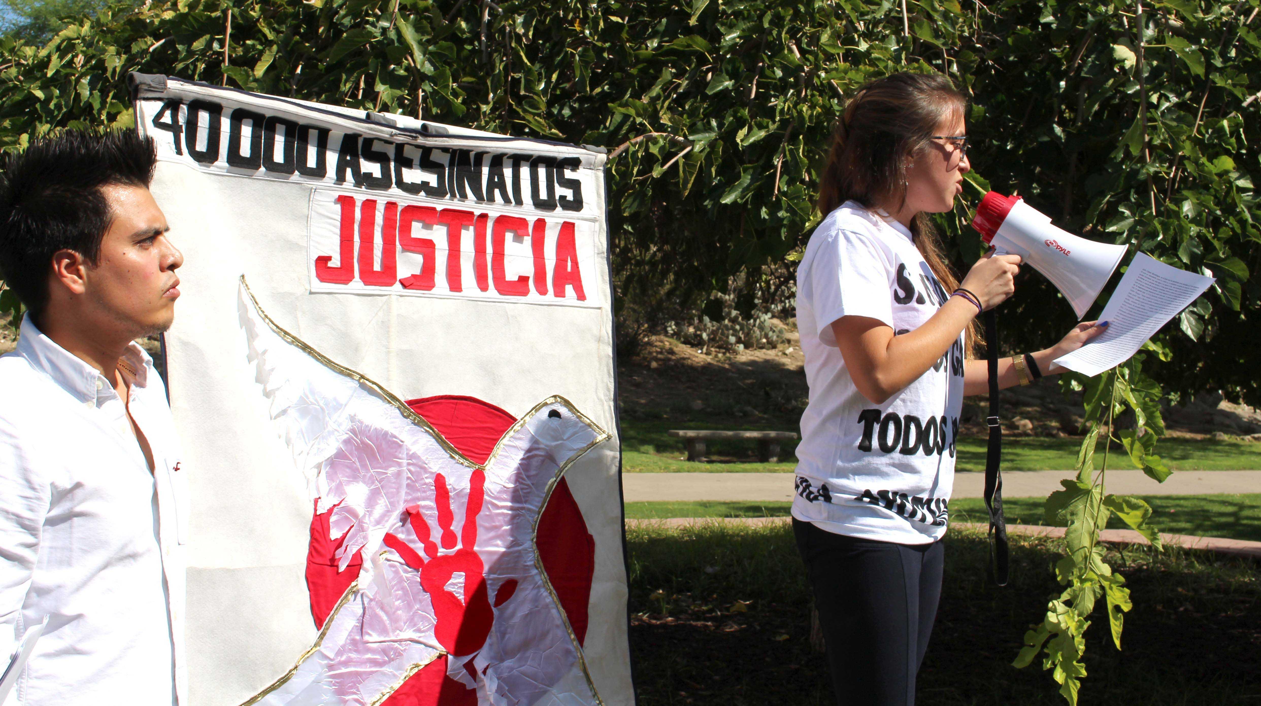 Sharon Murillo, graduate philosophy major, speaks at Wednesday's protest.
