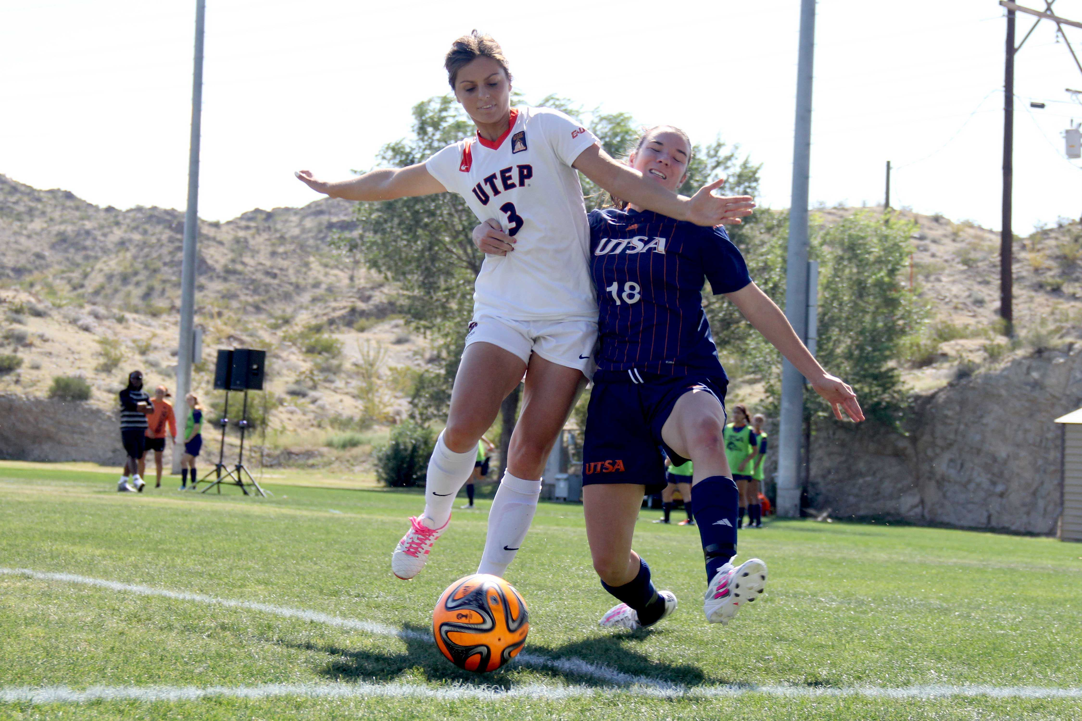 Senior center back Hannah Asuchak attempts to steal the ball from a UTSA midfielder.