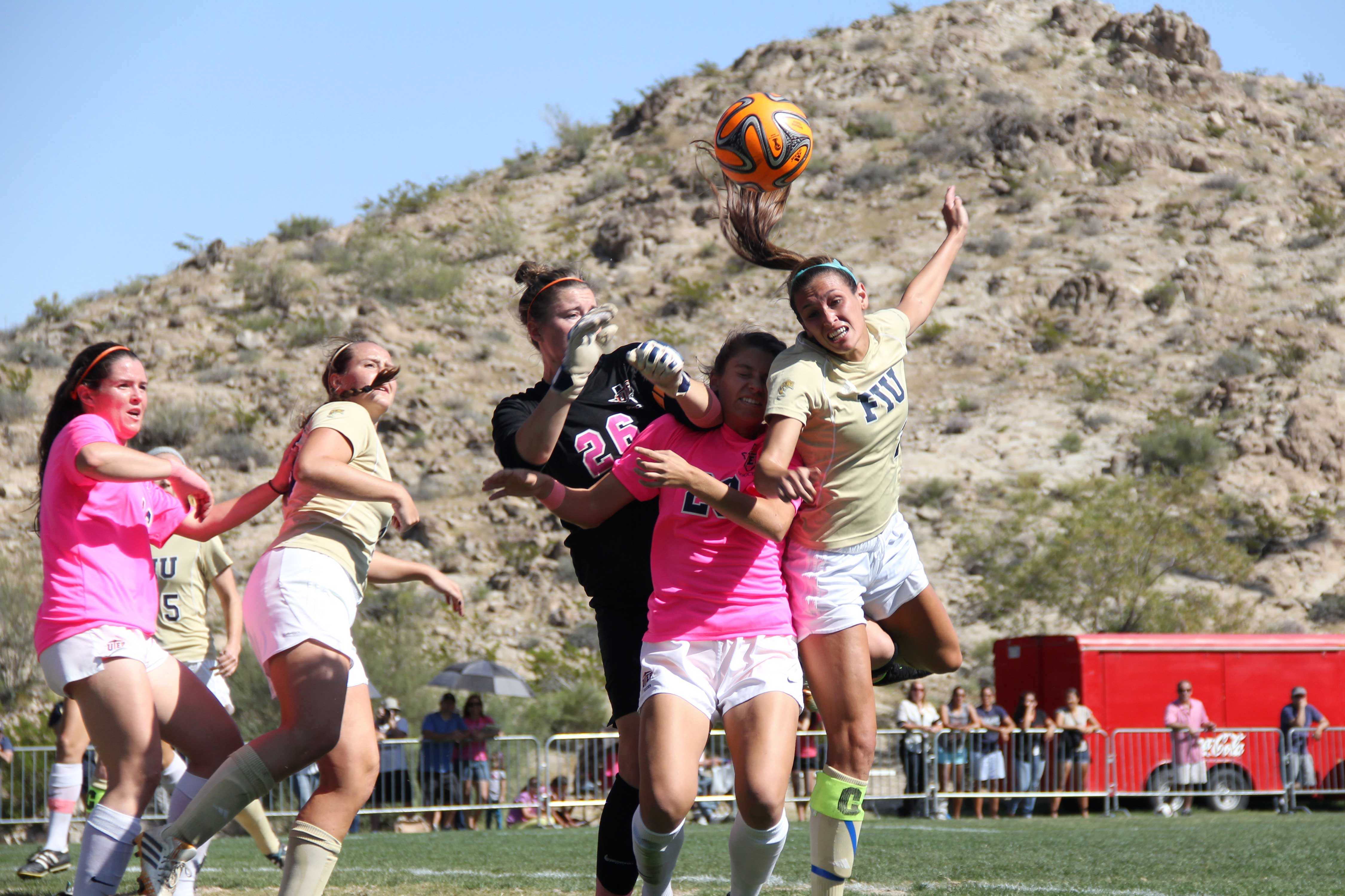 UTEP goalkeeper Sarah Dilling attempting a save.