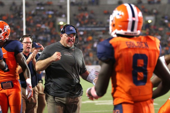 Coach+Sean+Kugler+congratulates+his+offense+after+another+touchdown.+