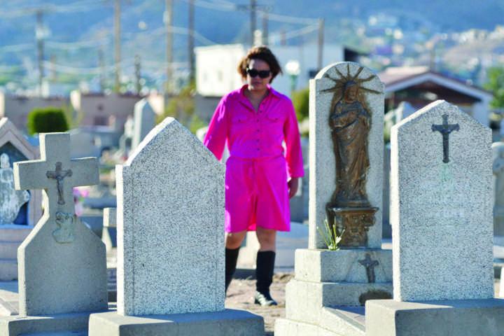 Woman walks around Concordia Cemetery last year on Día De Los Muertos.