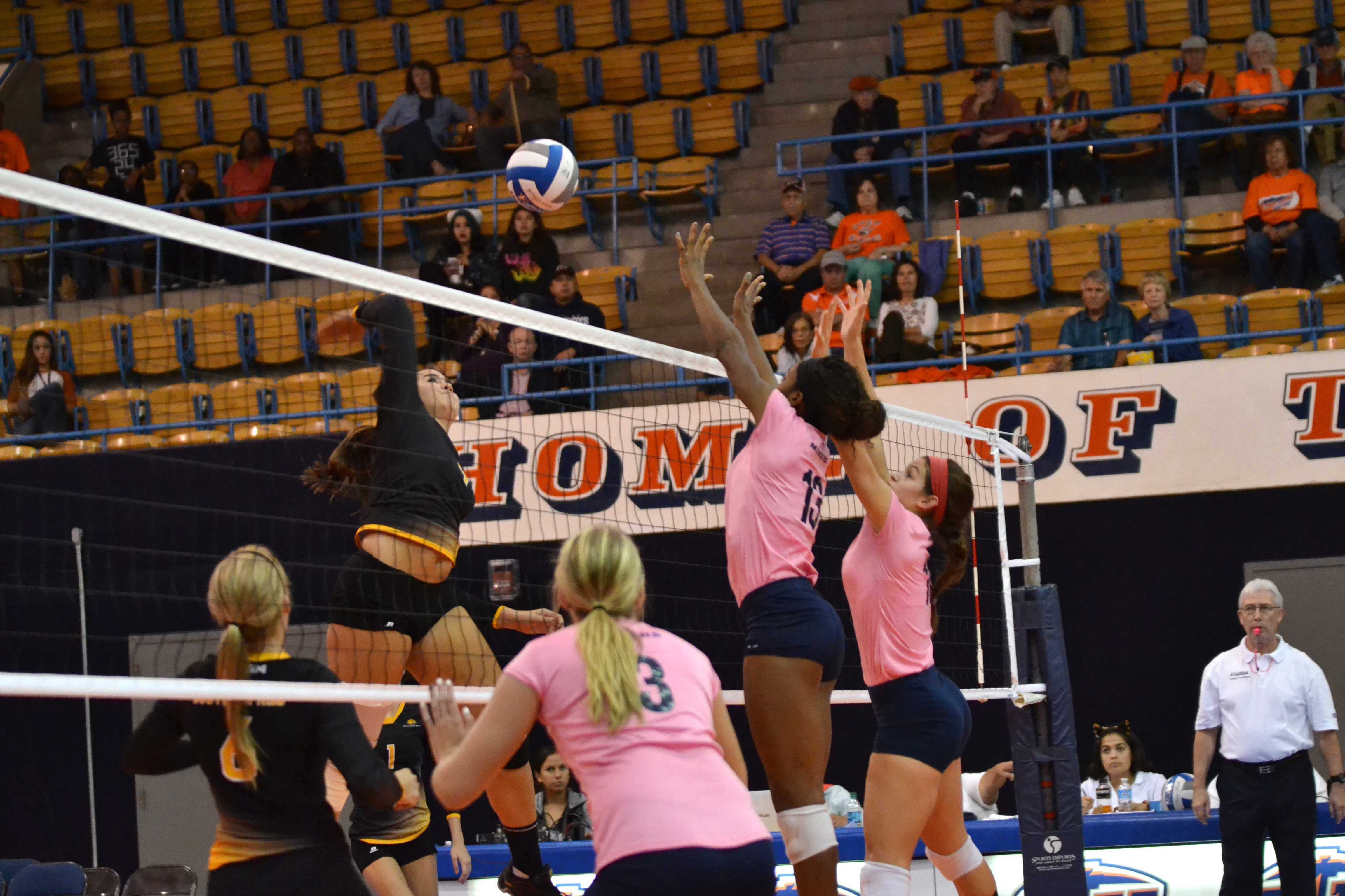 Krystal Ejesieme (left) and Lindsey Larson (right) jump to attempt a block on the Southern Miss attack