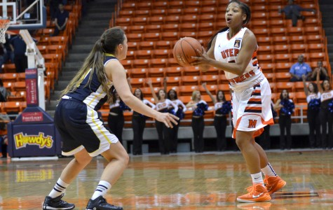Freshman guard Lulu McKinney attempts a pass into the low post.