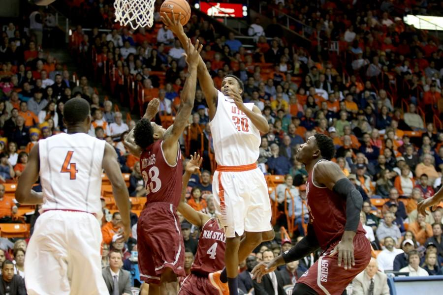 Junior guard Earvin Morris attempts a layup over Aggie defenders.
