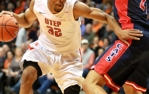 Sophomore forward Vince Hunter drives ball past Wildcat defender for a basket.