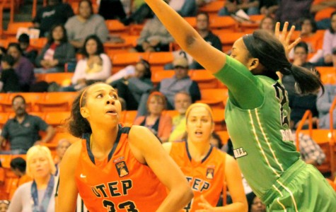 UTEP Forward Daeshianna McCants attempts to evade a player for the basket.
