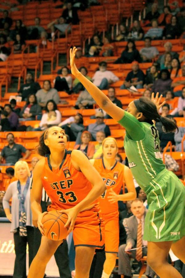 UTEP+Forward+Daeshianna+McCants+attempts+to+evade+a+player+for+the+basket.+