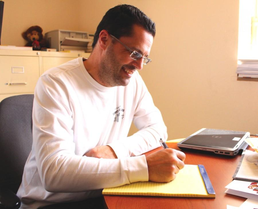 Dr. Stephen L. Crites works in his office with research on stereotypes and judgements.