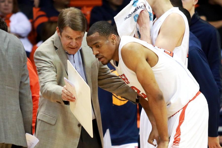 Head coach Tim Floyd discusses a play with Senior forward Vince Hunter.