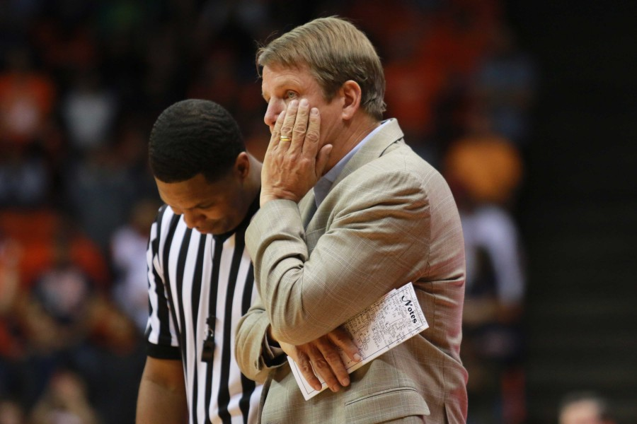 Head coach Tim Floyd questions a call with the referee.