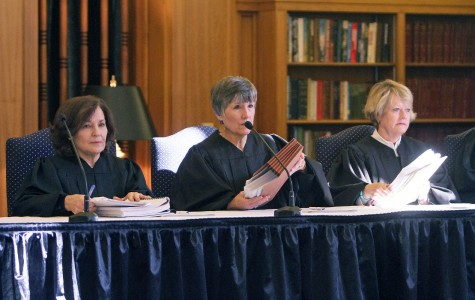 Presiding Judge Sharon Keller (left), Judge Cheryl Johnson and Judge Barbara Hervey address the audience and begin the first oral argument on capital murder.