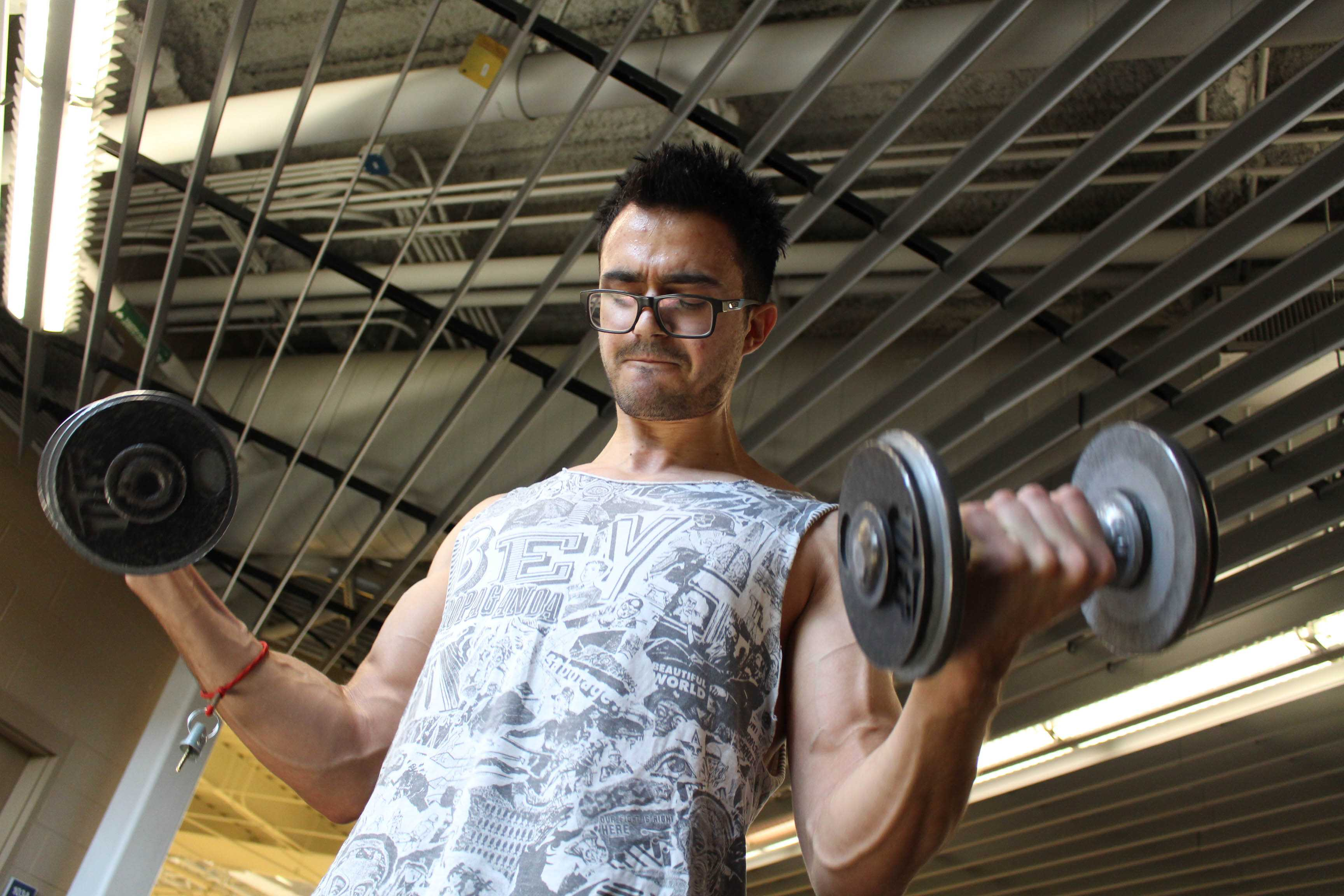Senior music theory and composition major, Roberto Loya lifts weights at the UTEP recreation center
