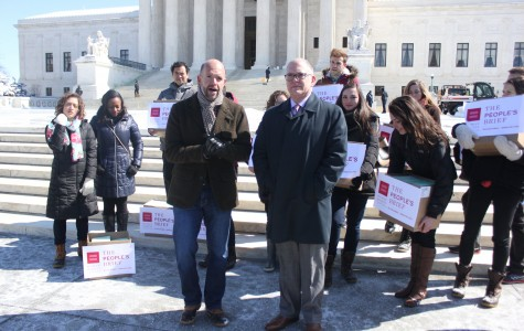 Fred Sainz, left, of the Human Rights Campaign, and Jim Obergefell, the lead plaintiff in the same-sex marriage case before the Supreme Court, and volunteers deliver what they call the People's Brief, in advance of the April 28 argument in the case.