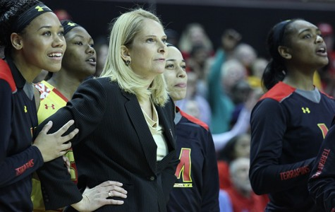 Maryland women's basketball coach Brenda Frese stands with her players during Monday's NCAA Tournament game against Princeton. Frese, a national championship-winning coach, makes less than half of men's coach Mark Turgeon